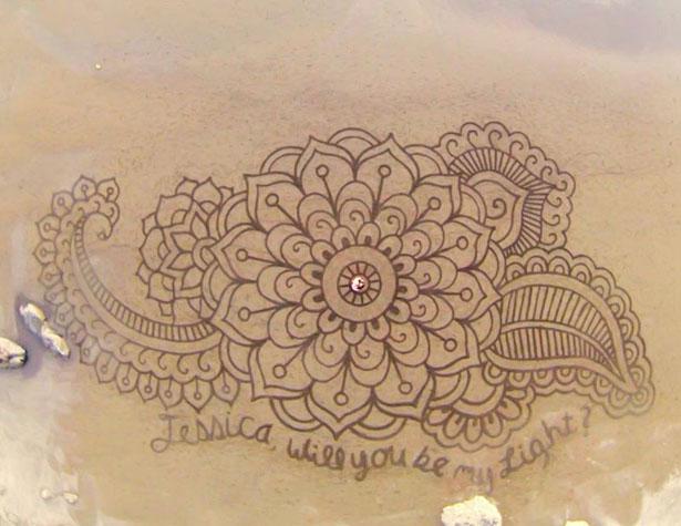 beach-sand-art-with-a-by-rake